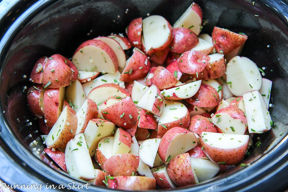 Raw red potatoes cooking in the crock pot.