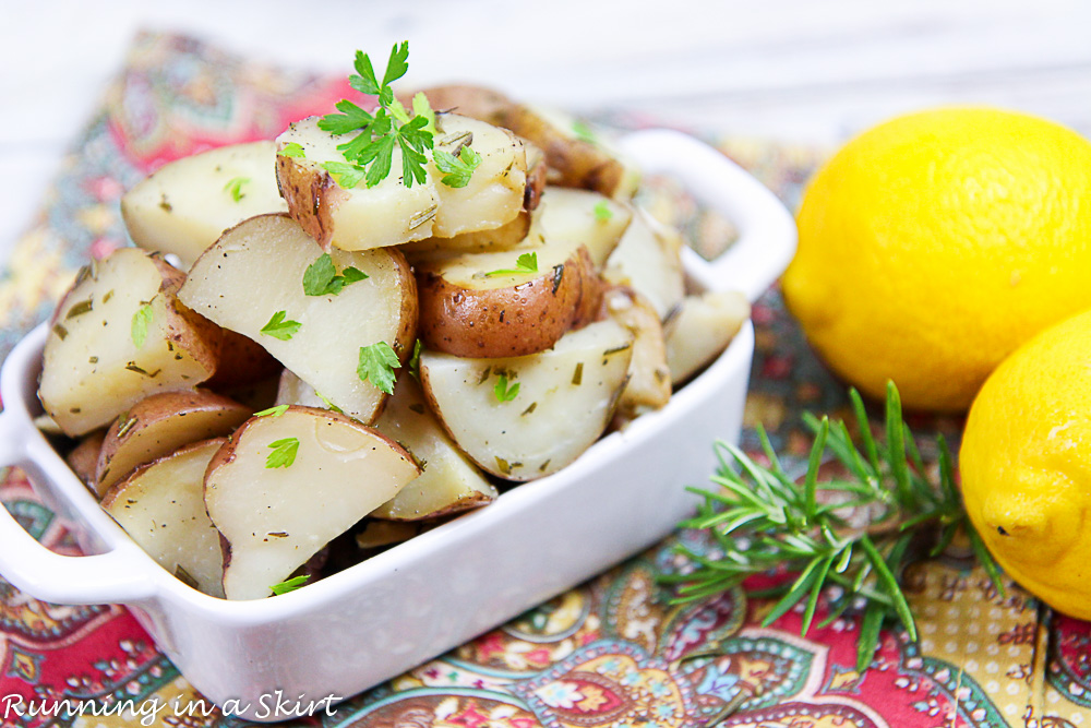 Crock Pot Rosemary Potatoes in a white bowl with lemon.