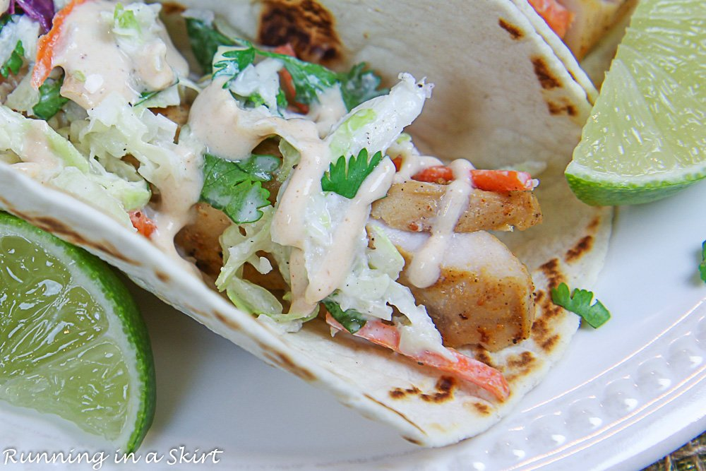 Close up of the healthy Mahi Mahi Fish Taco with the Chipotle Sauce drizzled on top.