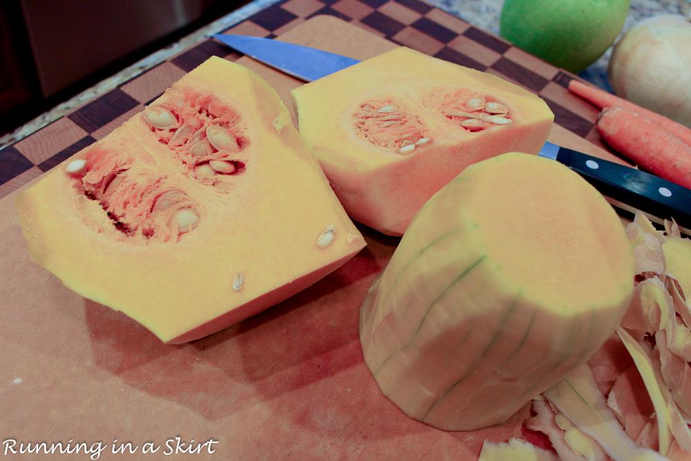 Cut whole butternut squash on a cutting board show how to cut the squash.