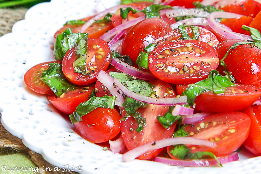 Marinated Cherry Tomatoes salad on a white plate.