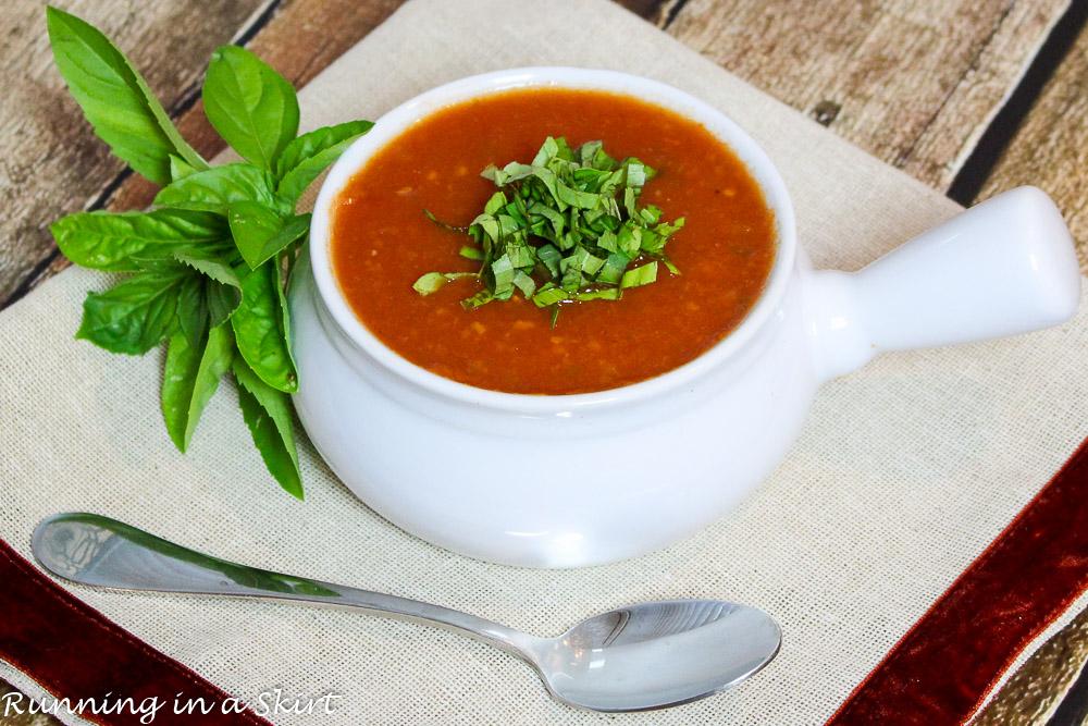 Easy Vegetarian Crock Pot Tomato Basil Soup in a white bowl.