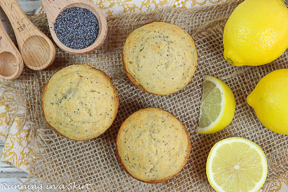 Overhead shot of the muffins, lemon and poppy seeds.