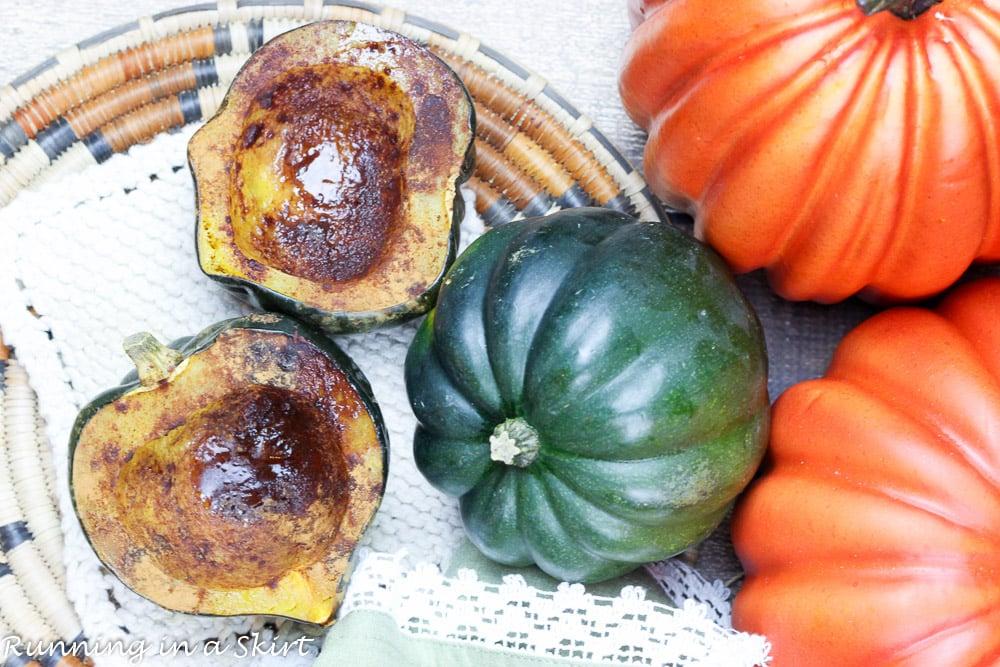 Easy Healthy Baked Acorn Squash halves next to full sized squash.