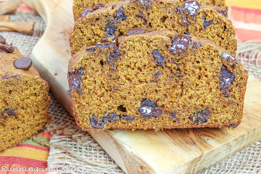 Finished product with a slice of the Healthy Greek Yogurt Pumpkin Bread.