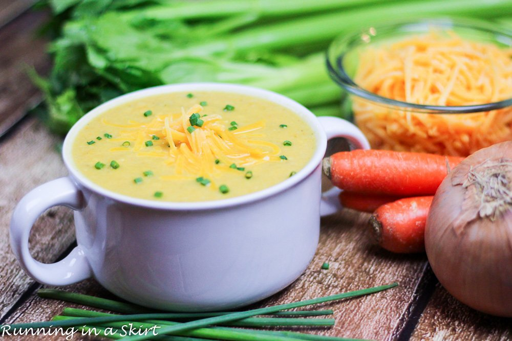 Cauliflower soup in a white serving bowl.