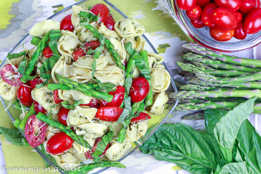 Overhead shot of asparagus, tomato and basil.