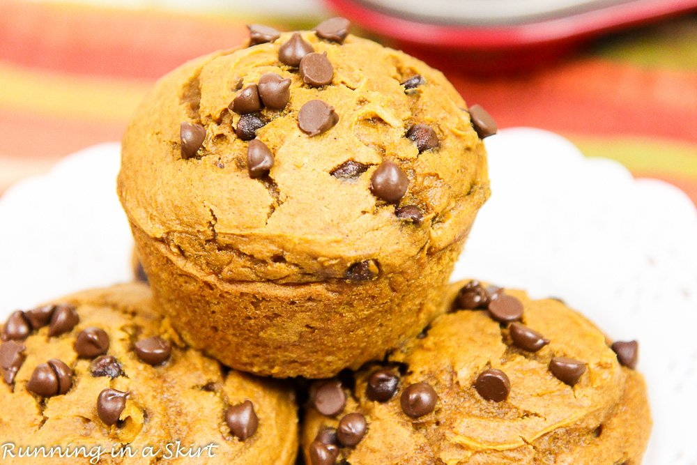 3 Ingredient Pumpkin Chocolate Chip Muffins stacked on a white plate.