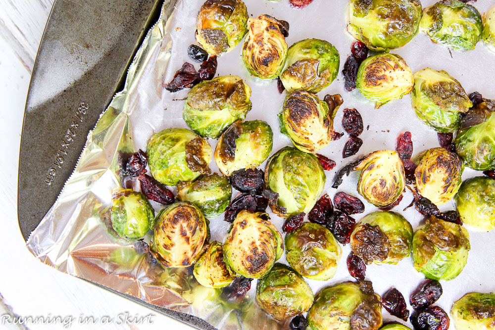 Maple Balsamic Brussels Sprouts and Cranberries on a baking sheet.