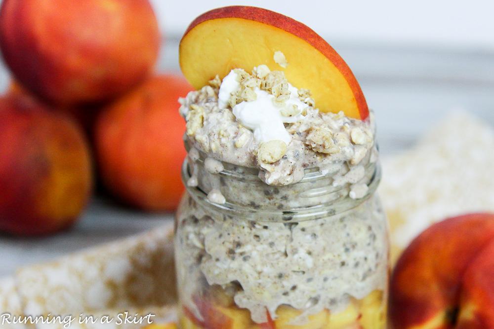 Healthy Peach Cobbler Overnight Oats in a mason jar with a peach on top.