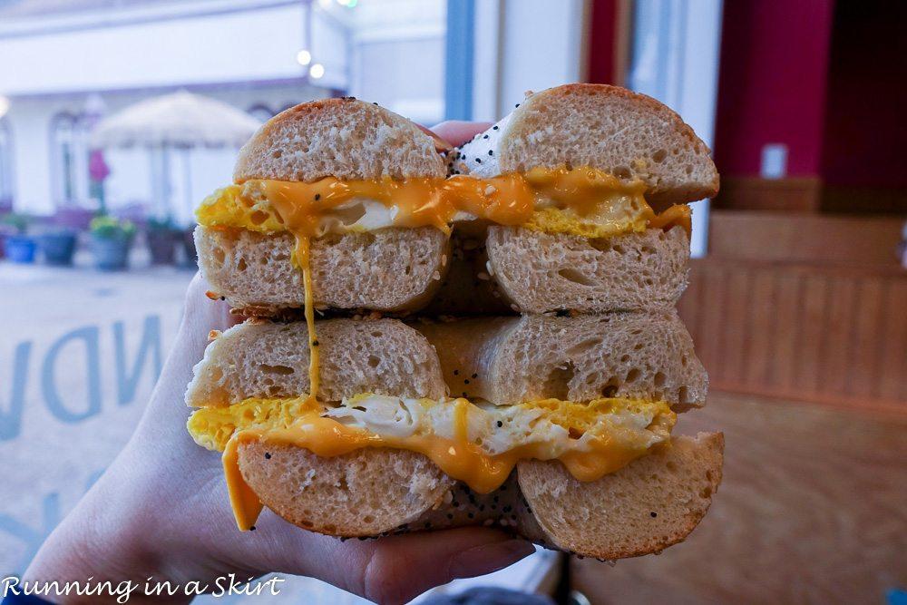 Best Breakfast restaurants in Hilton Head- Island Bagel and Deli - bagel sandwich held in hand.