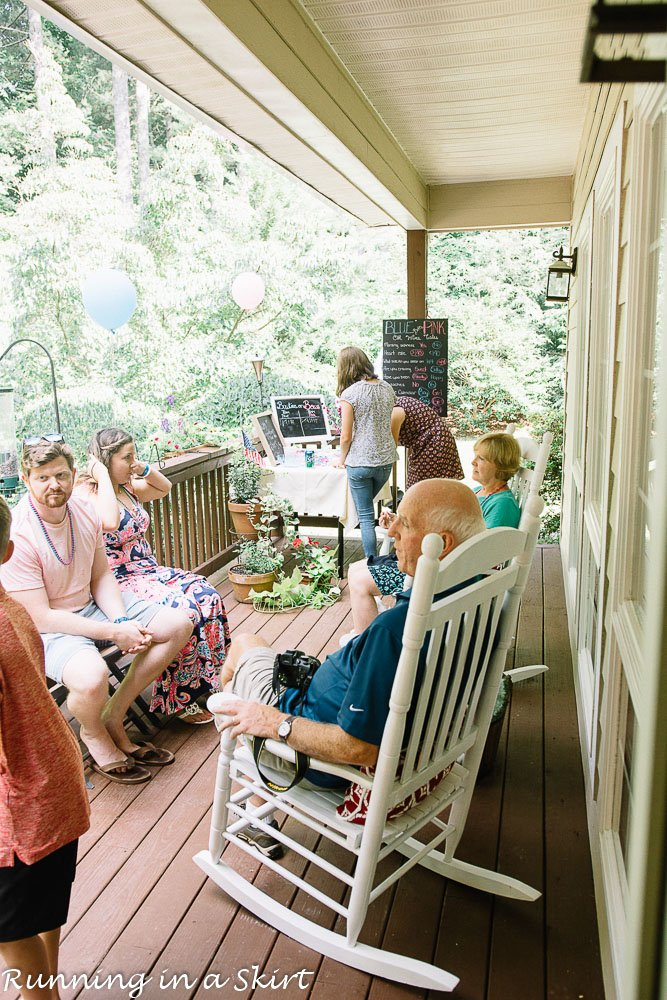 Outdoor crowd at twin gender reveal party.