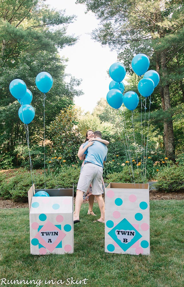 Twin boy gender reveal with blue balloons.