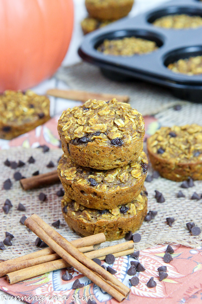 Pumpkin Baked Oatmeal Cups with pumpkin and baking dish in the background.