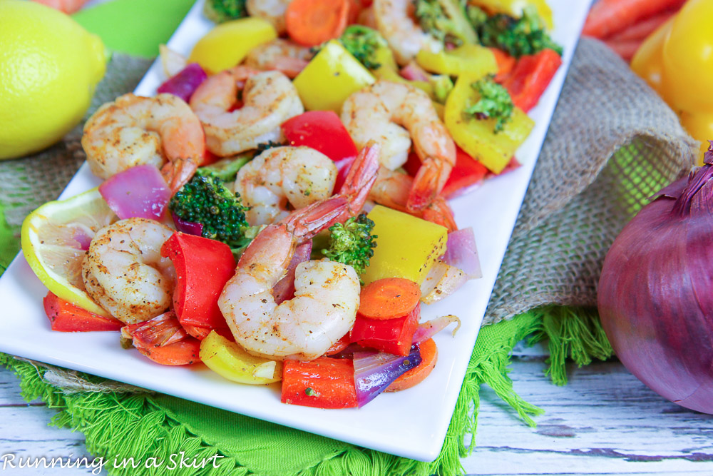 Sheet Pan Shrimp and Vegetables recipe on white plate with a napkin.