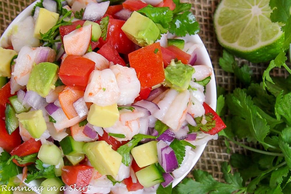 Overhead shop with shrimp, tomato, lime, avocado and onion