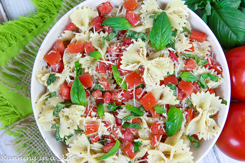 Overhead shot of Bruschetta Pasta Salad recipe in a flat white bowl.
