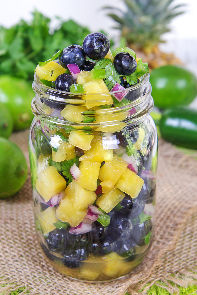 Easy Blueberry Salsa recipe with pineapple in a mason jar.
