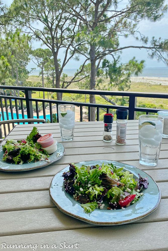 Plates on table overlooking ocean.