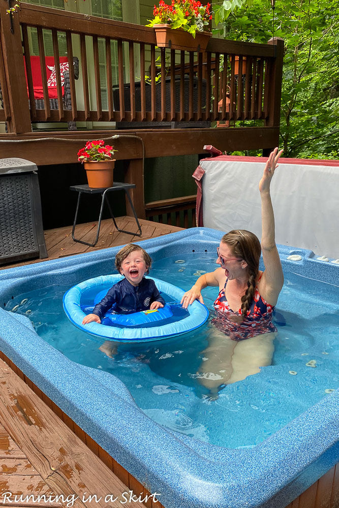 Toddler in a pool learning toddler swim safety.