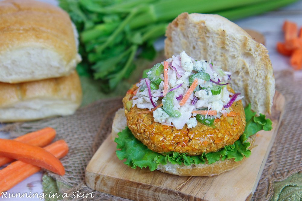 Buffalo Chickpea Burger recipe with Blue Cheese coleslaw on top of a wooden cutting board.