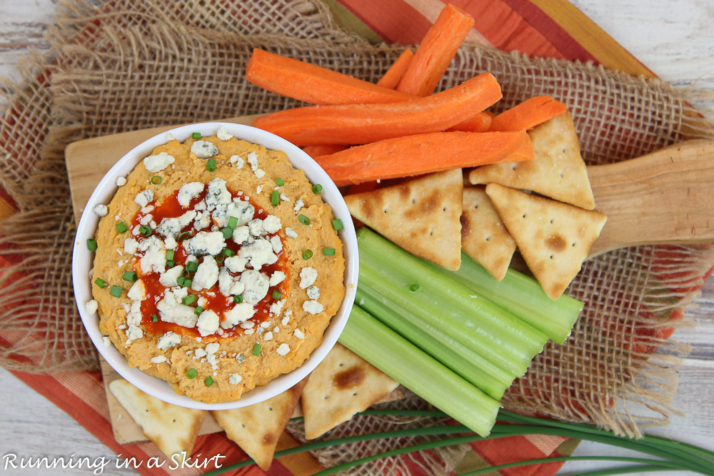 Buffalo Hummus with carrots, celery and crackers.