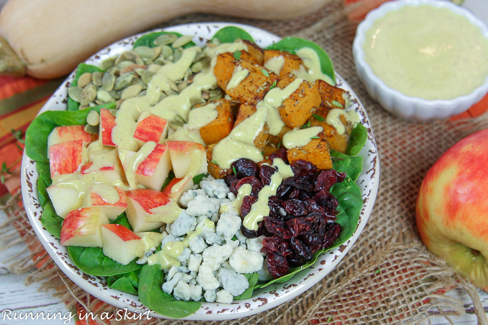 Salad in a bowl with apples, butternut squash and pumpkin seeds.