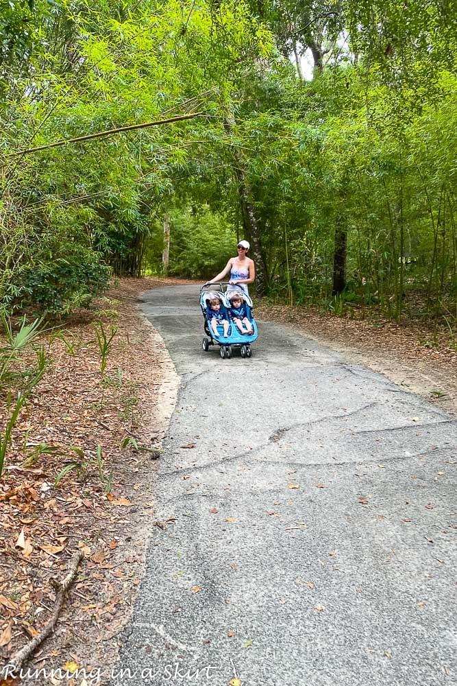 Mom pushing stroller on walking paths on Kiawah Island SC.