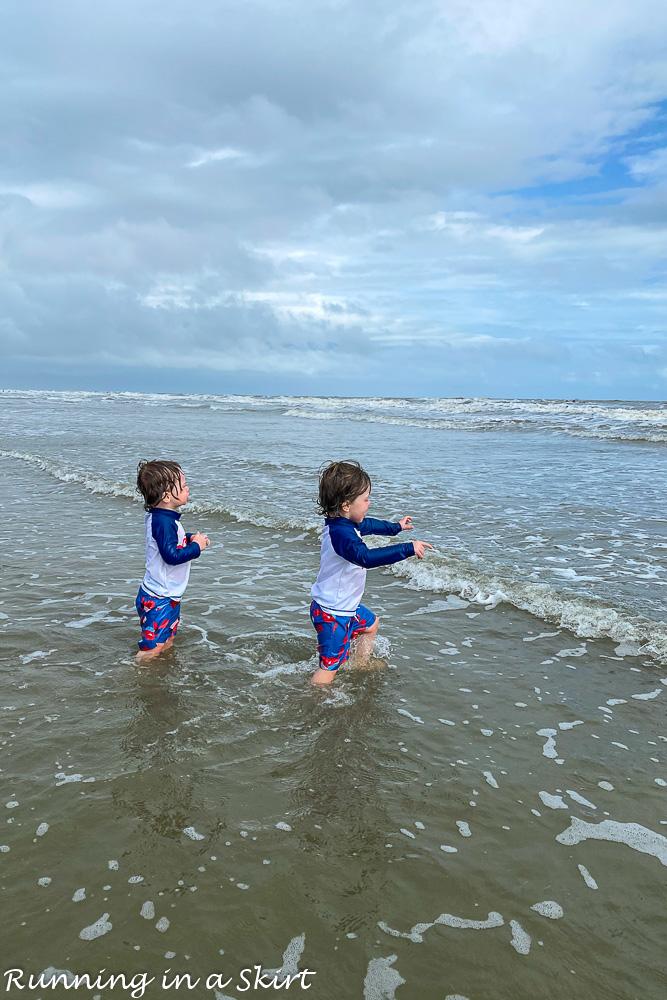 Toddlers running into water on beach Kiawah Island South Carolina