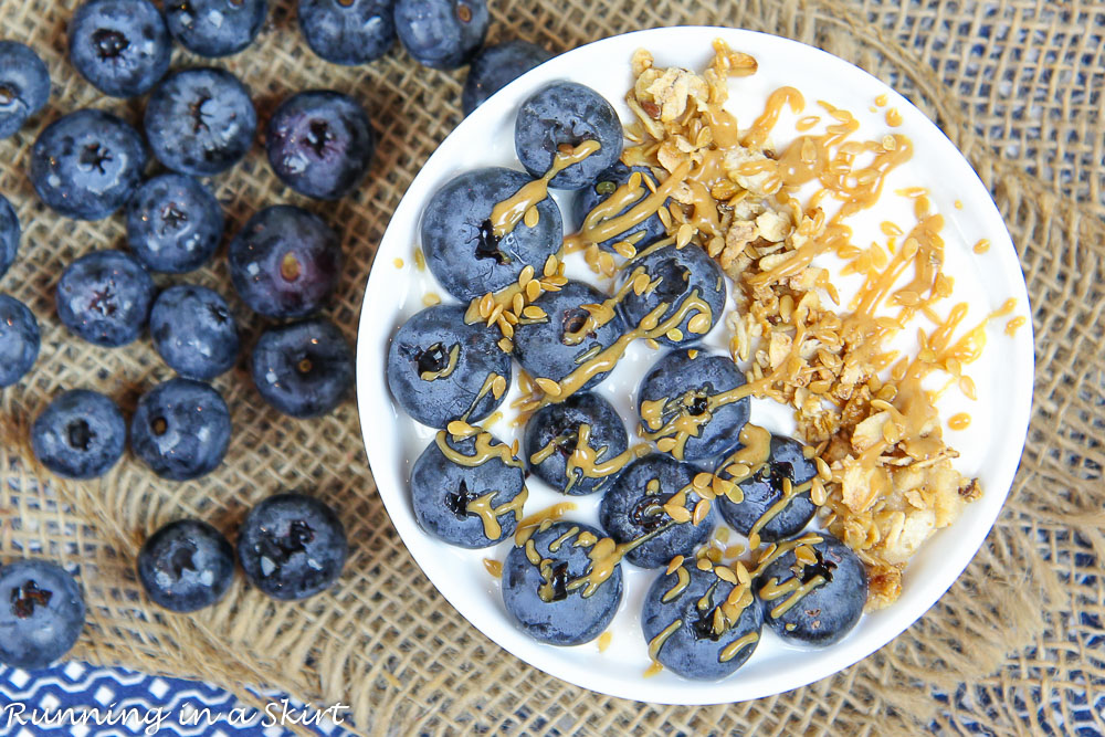 Blueberry Pie Greek Yogurt Bowl on a napkin with extra blueberries.