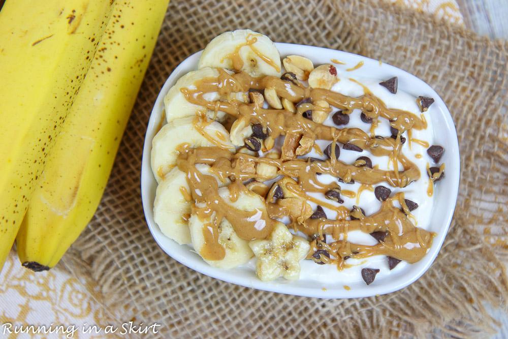 Chunky Monkey Greek Yogurt bowl on a napkin with a banana.