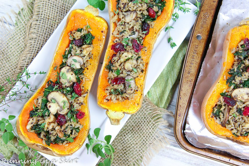 Finished product Vegan Stuffed Butternut Squash on a white plate with herbs.