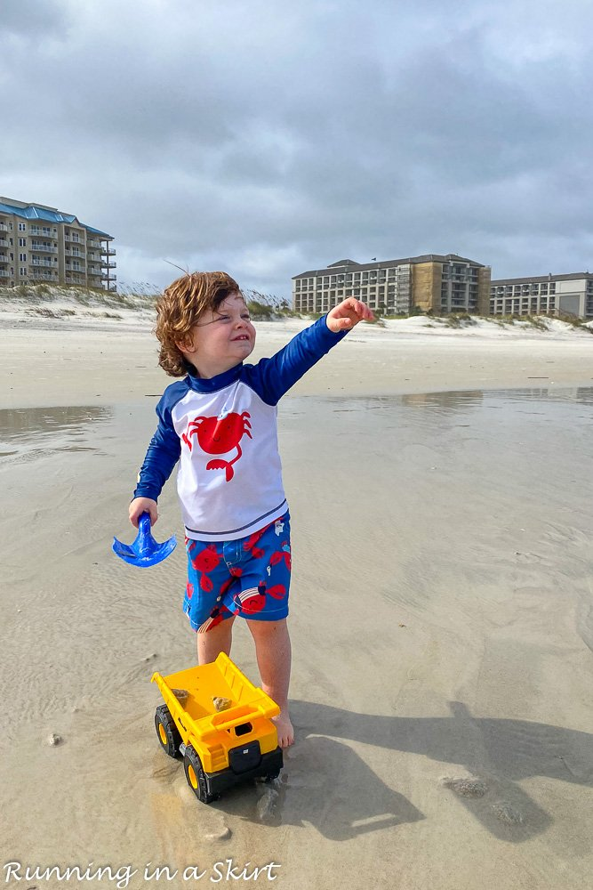Toddler with a truck on Amelia Island beach.