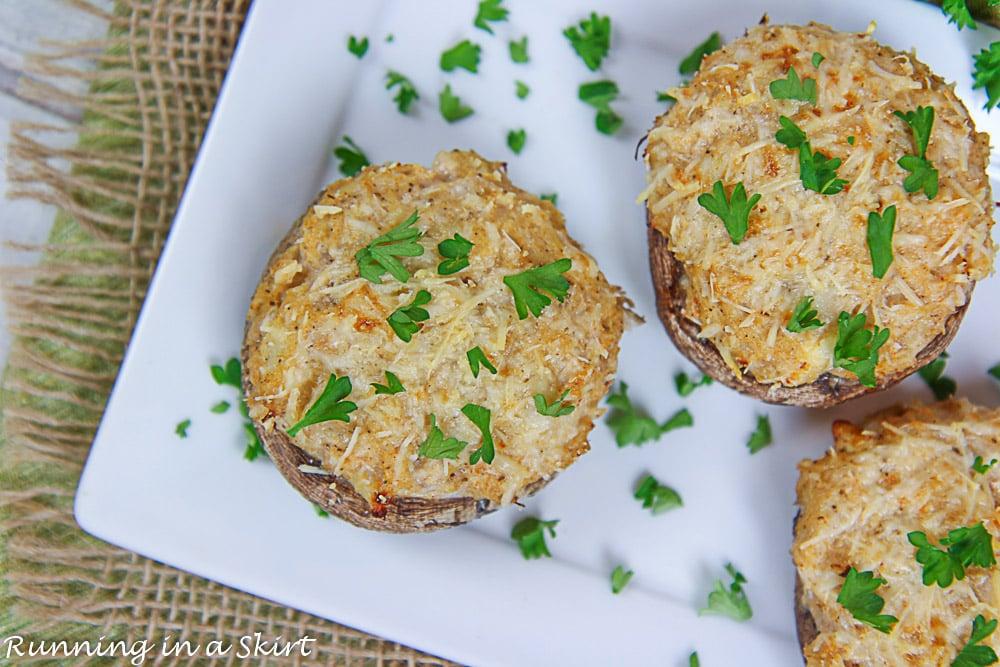 Healthy Crab Stuffed Portobello Mushrooms on a white plate.