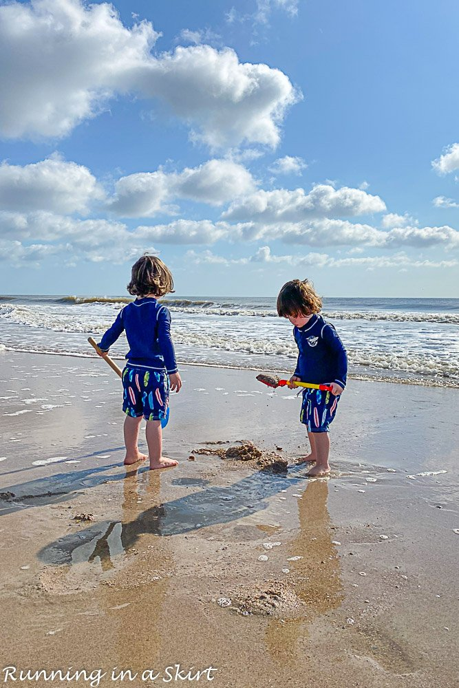 Twins playing on the beach at Amelia Island.