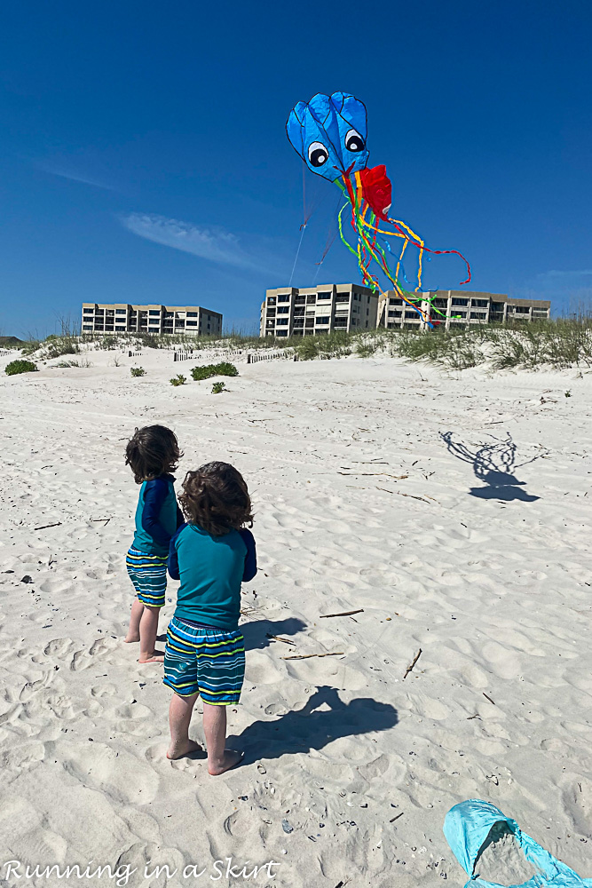 Flying kites on beach.
