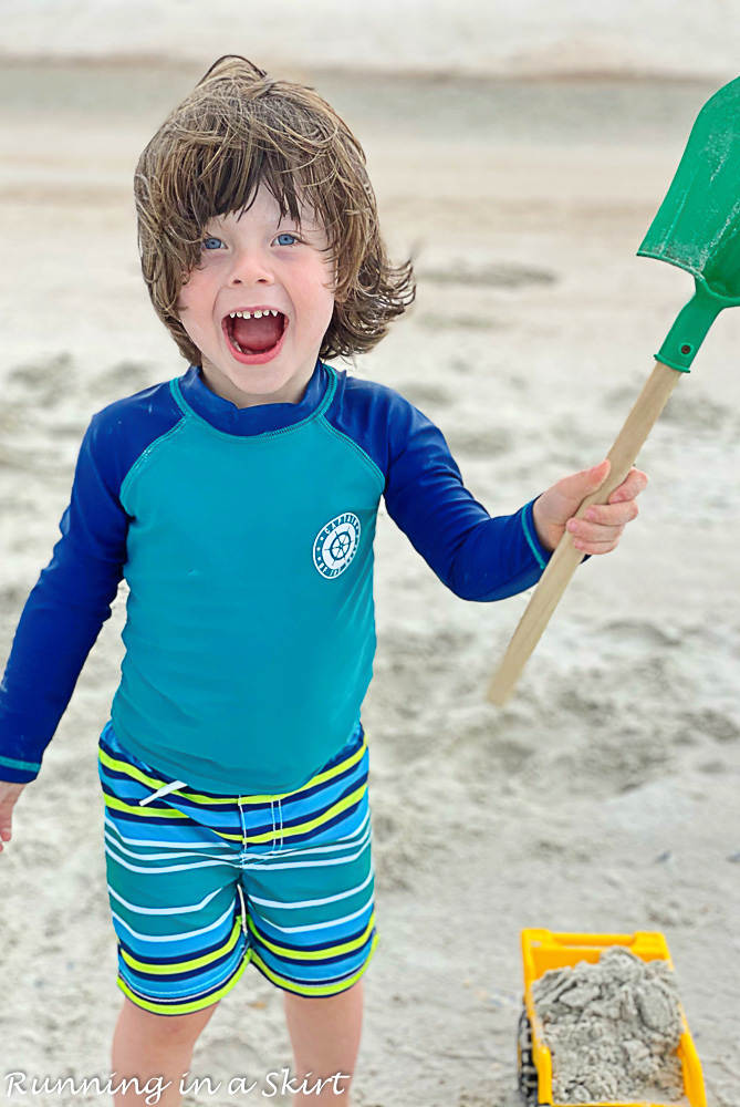 Kid smiling on Amelia Island Beach.