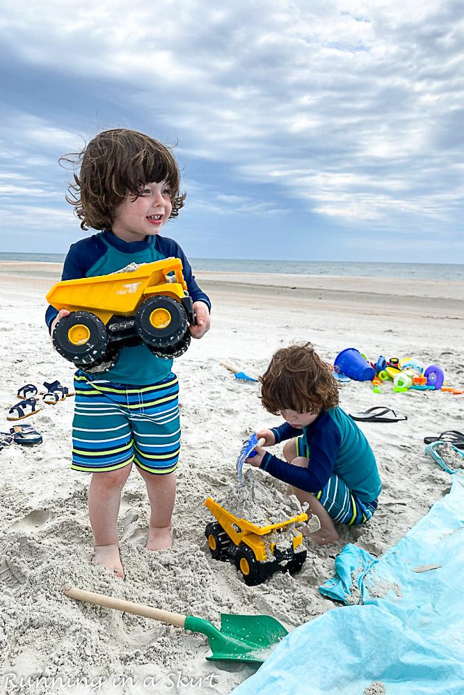 Kids playing with truck on Amelia Island beach.