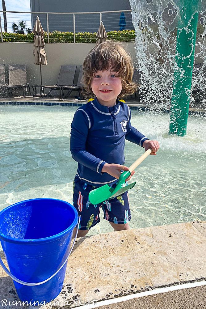 Toddler playing in Ritz Carlton Amelia Island pool.