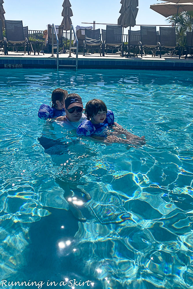 Family playing in Amelia Island pool.
