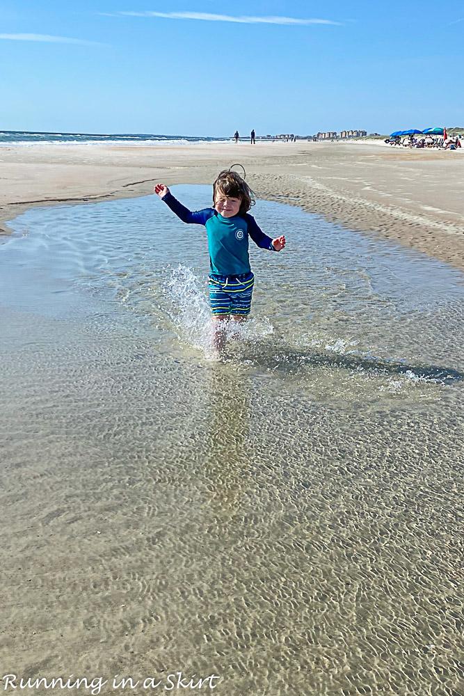 Boy playing in a tidepool.