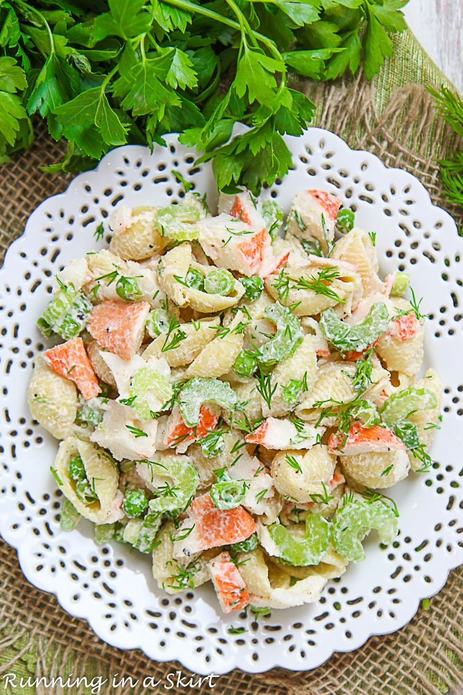 Crab Pasta Salad on a white plate with parsley.