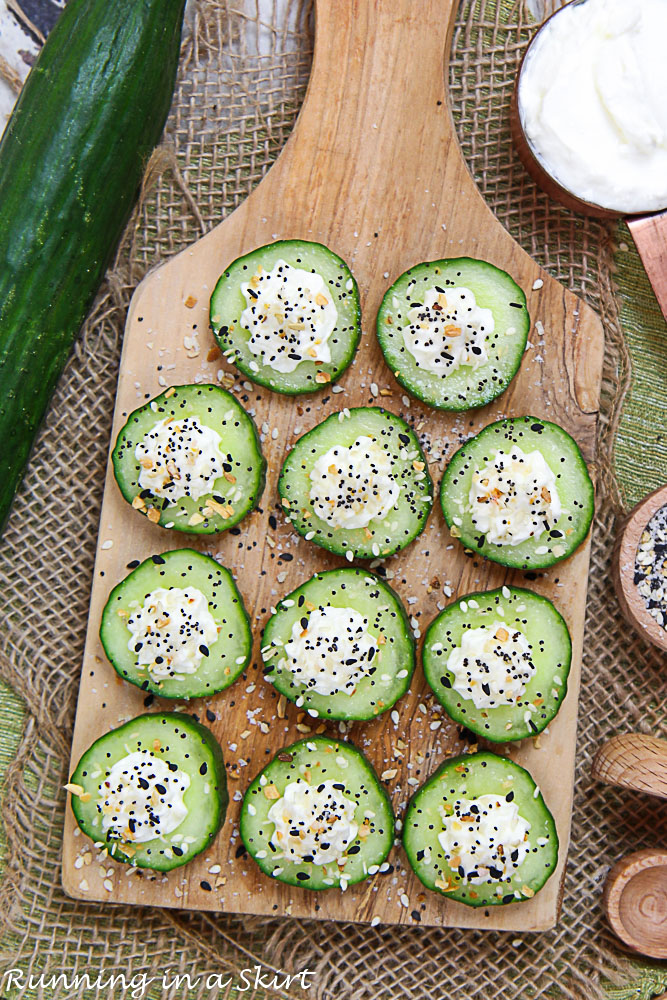 Overhead shot of the cucumber bites on a wooden cutting board.