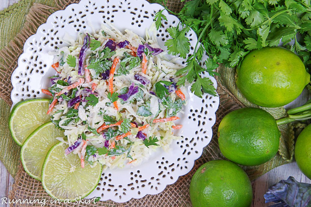 Overhead shot of Cilantro Lime Slaw with limes and cabbage.