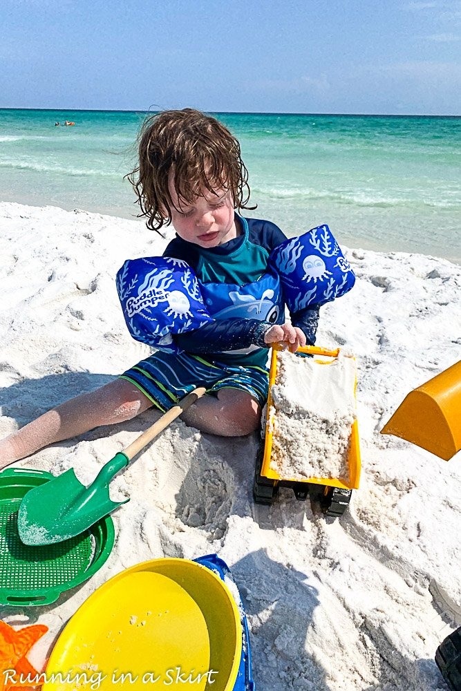 Destin Florida beaches with toddler playing with dumptruck.