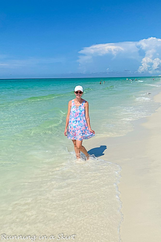 Destin Florida Travel Guide showing person in the water at the beach.